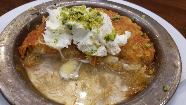 Kanafeh, a delicious , cheesy dessert, soaked in sugar syrup